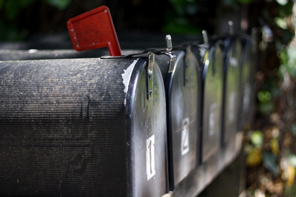 newsletter row of black mailboxes